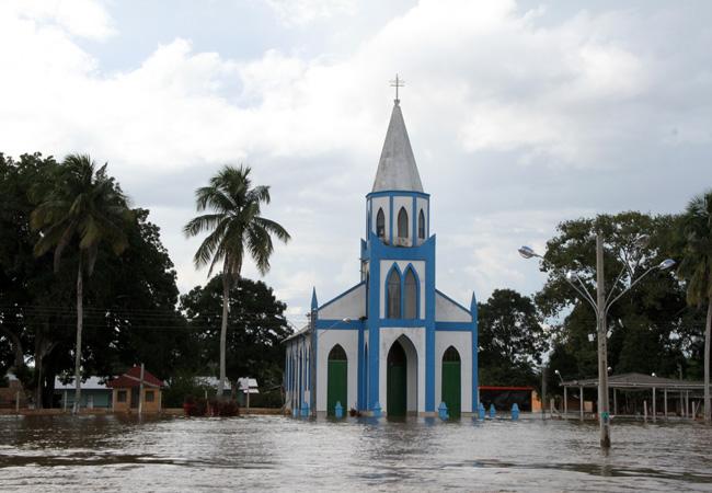 Distrito de São Carlos foi inundado pelas águas do Madeira (Foto: Marcos Freire/Secom)