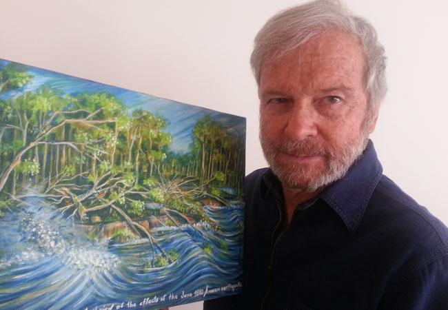 José Alberto Veloso ao lado da ilustração sobre possíveis efeitos do terremoto no Amazonas (Pintura de Marlene Costa)