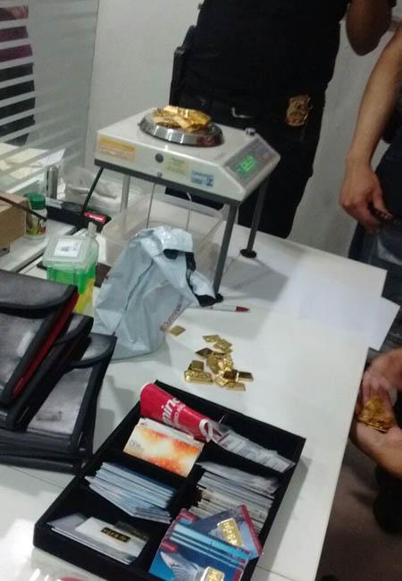 Agentes em ação de buscas em lojas de venda de ouro. (Foto: PF RR/07/15)