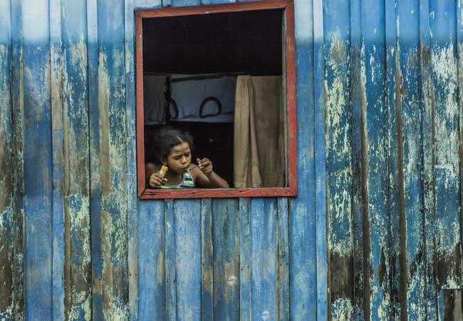 Menina de São Carlos, distrito que será removido por inteiro. (Foto: Marcela Bonfim/AmReal)